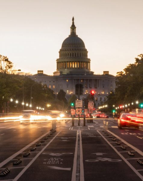 Commuters are already moving about before dawn on the streets of Washington DC United States Capital City